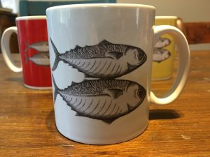 Artify Alice mug featuring mackerel etching with a white background