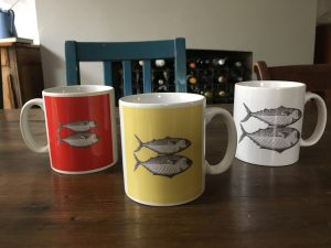 Artify Alice mackerel etching design on a range of mugs