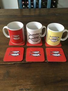 Artify Alice mugs and coasters featuring the mackerel etching